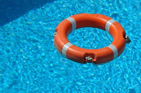 Life buoy floating in pool